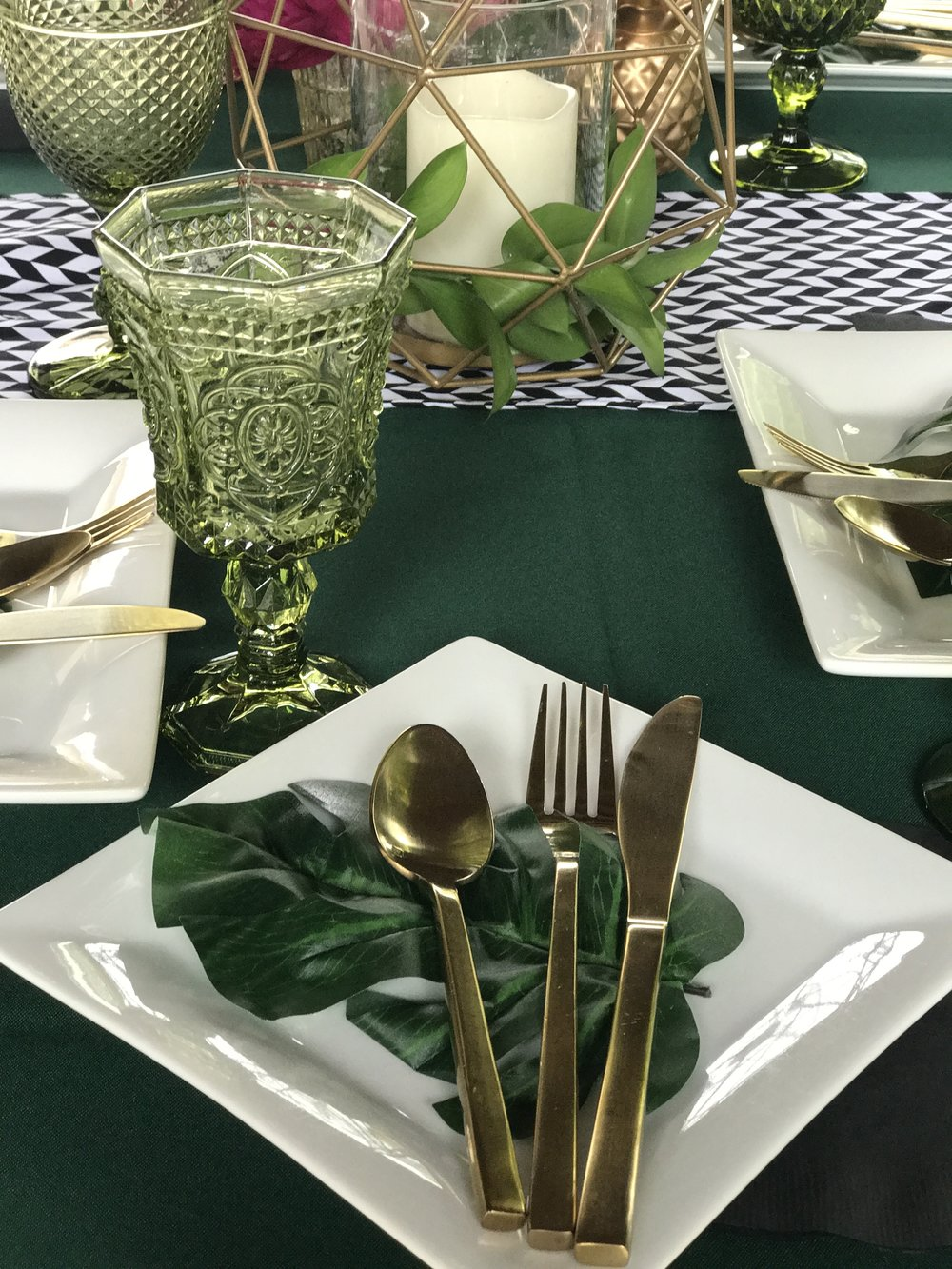 The variety of green goblets and gold flatware were provided by  Party Pleasers  in Camarillo. All other items were provided by Down Emery Lane.