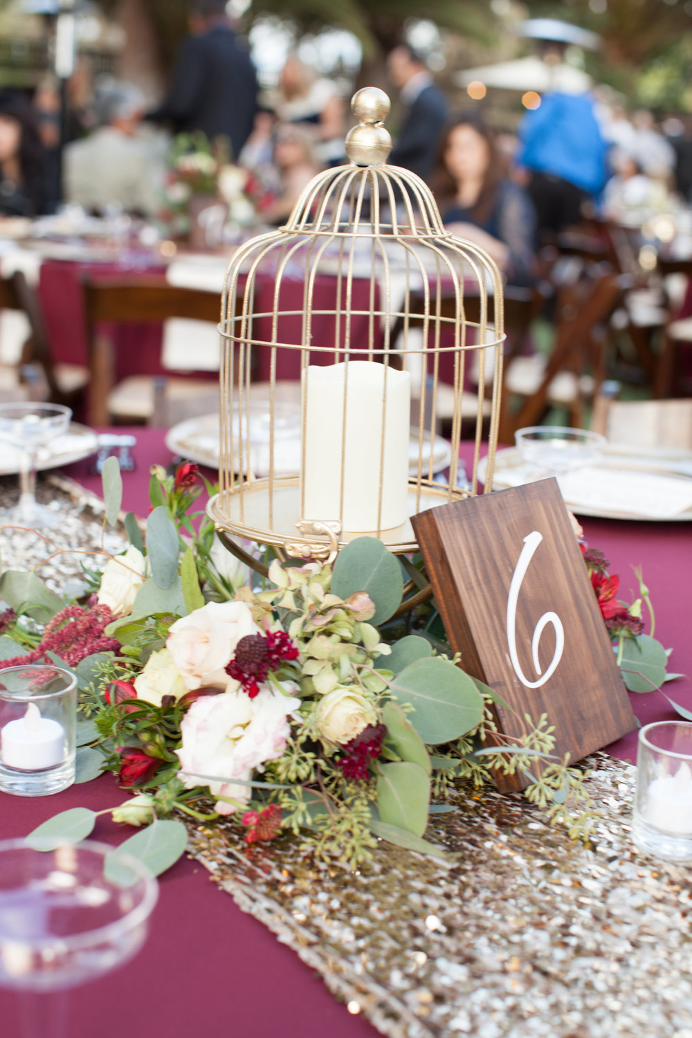 Gold birdcages, burgundy flowers & wood table signs by Down Emery Lane.