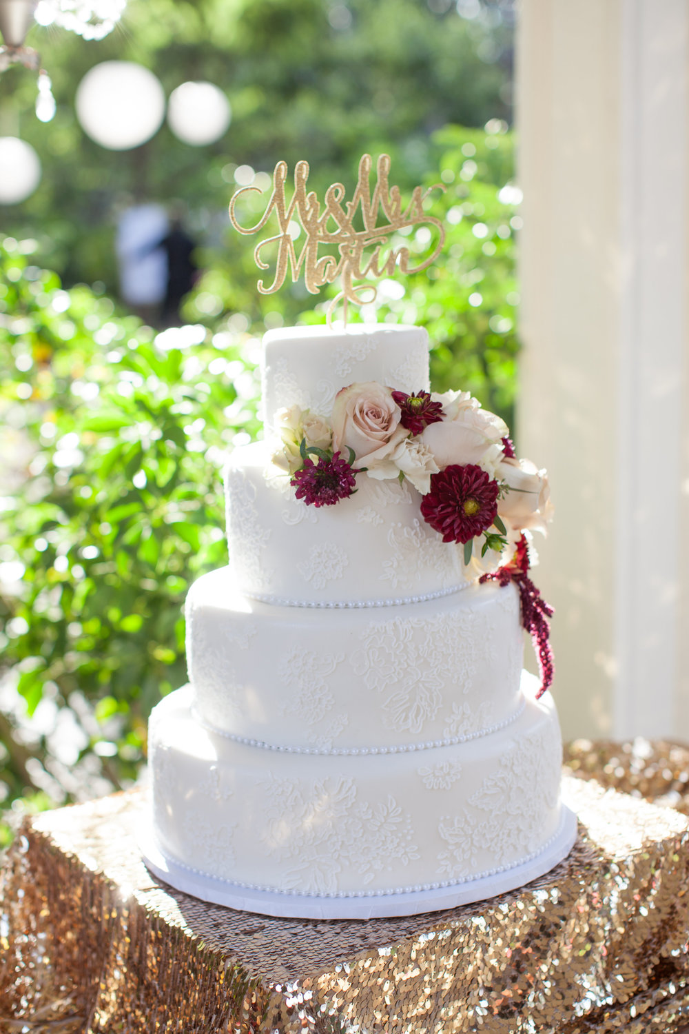 Lace, cream and merlot wedding cake.