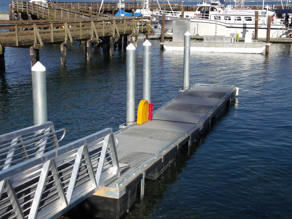 Boat Ramp Dock at Langley, WA for The Port of South Whidbey Launch Spring 2013. Eco Series Steel Dek and Pier Series Steel Dek used together in Grey with Black Texture. Dock Designed by Reid Middleton Engineers Everett, WA. General Contractor Neptune Marine Anacortes, WA.