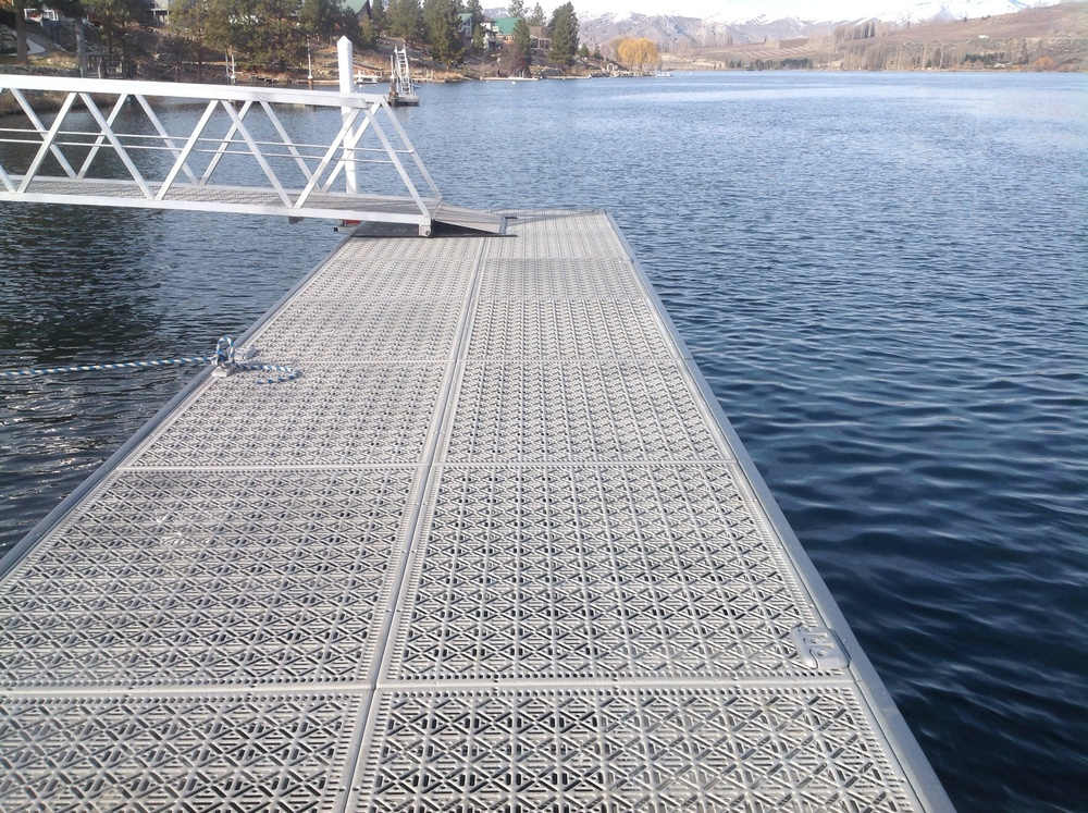 The Dock Company in Chelan, WA using Steel Dek Eco Series panels for docks and gangways on the Columbia River February 2014. The USACE required 60% open area decking on new docks on the river.