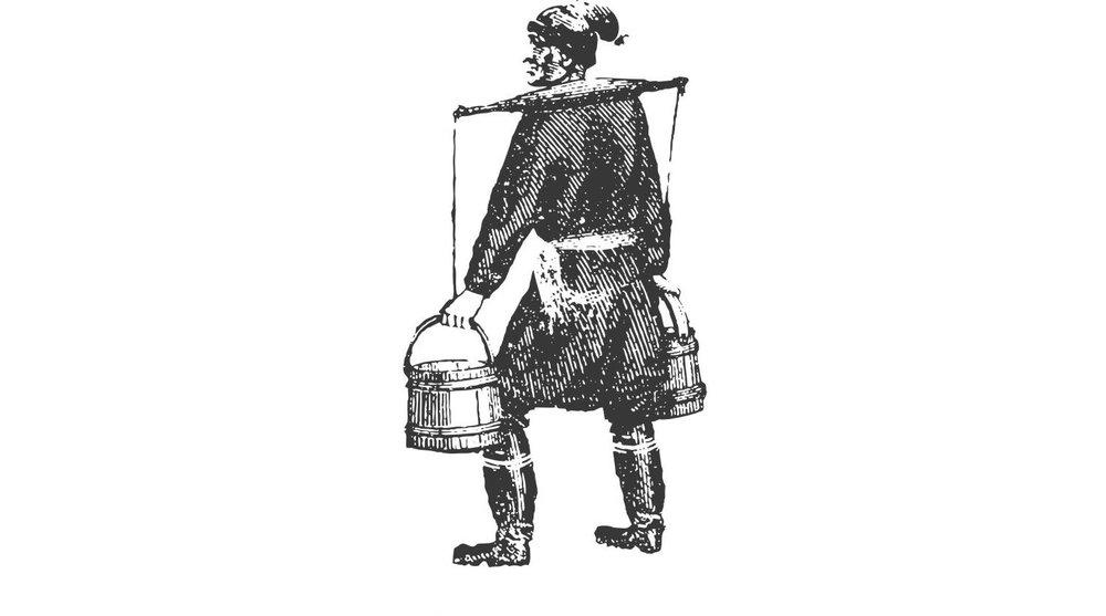 With the help of graphic designer Scott Gladd, the Cosman & Webb logo was created. European settlers traditionally collected syrup in wooden buckets hung from a yoke placed across their shoulders, like the one shown in the image.