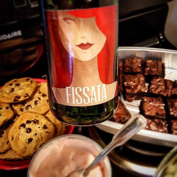 "Fissata Sweet Red - ""Why we love it? Fun, fizzy and festive - it's dessert in a glass. (Warning: Also pairs delightfully with any sweet treat.)""""Translucent, dark watermelon red in color, this release opens with floral, sweet-ish stone fruit over a raspberry-ish nose. A well-integrated palate of sweet fruity red berries and a nutty quality are repeated in the mouth. Gentle effervescence makes for an overall pleasing dessert wine experience."""