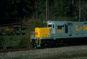 What is more Appalachian than an L&N C-420 passing a house up a holler? Here we do it on SARM's museum line.