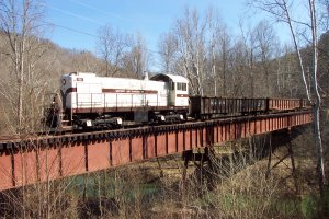 The freight train performs a runby on the bridge heading in to Blue Heron Mining Camp.
