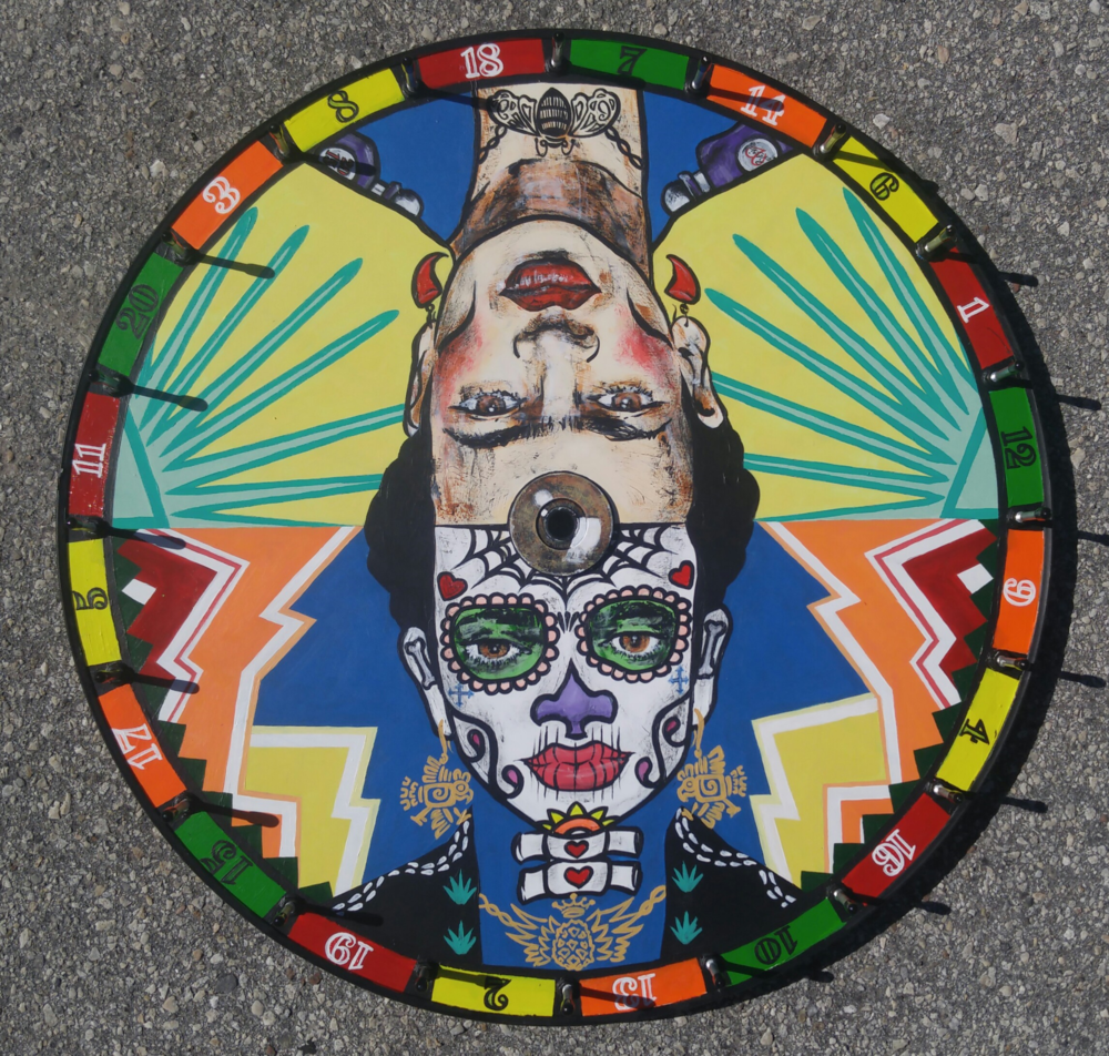 """Commisioned painting for Southern Wine & Spirits on a 24"""" Spinning Wheel for restaurant Tacolu, 1712 Beach Blvd in Jacksonville,FL, to be used as their drinking game."""