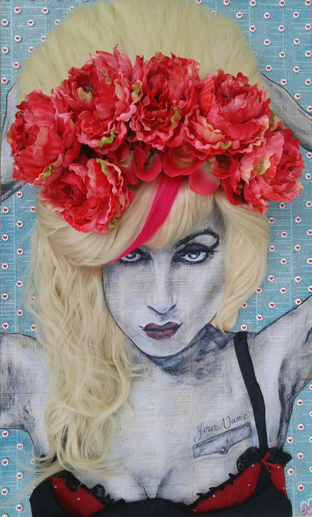 """Loves the Drug and I need to Score"",  22in. x 36in.   Mixed Media: Paper mached canvas with pills painted with small hearts on them. Acrylic paint for portrait. Hair extensions for hair. Large artificial flowers for head piece. False lashes for eyelashes. Bead for Monroe piercing. Fabric to make lingerie."