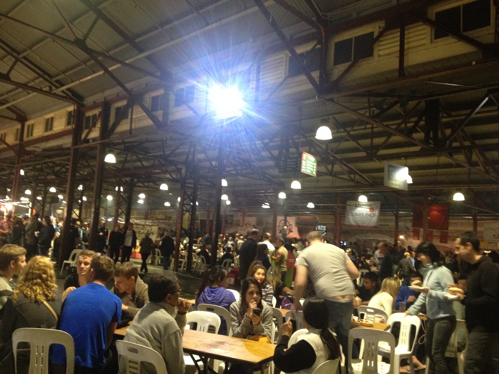 This is a hasty and crooked shot of just the tables. Along the back wall is all the food stalls. I'm somewhere in the middle of all of them.