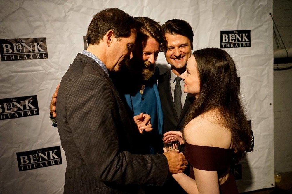 The Tragedy of JFK director Daniel Henning surrounded by The Kennedys on opening night. (Photo courtesy of Rick Baumgartner.)