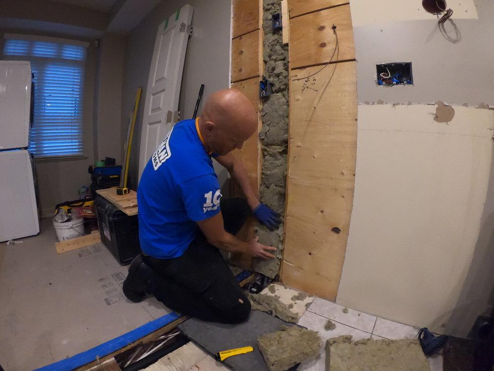 Joe filing wall with insulation