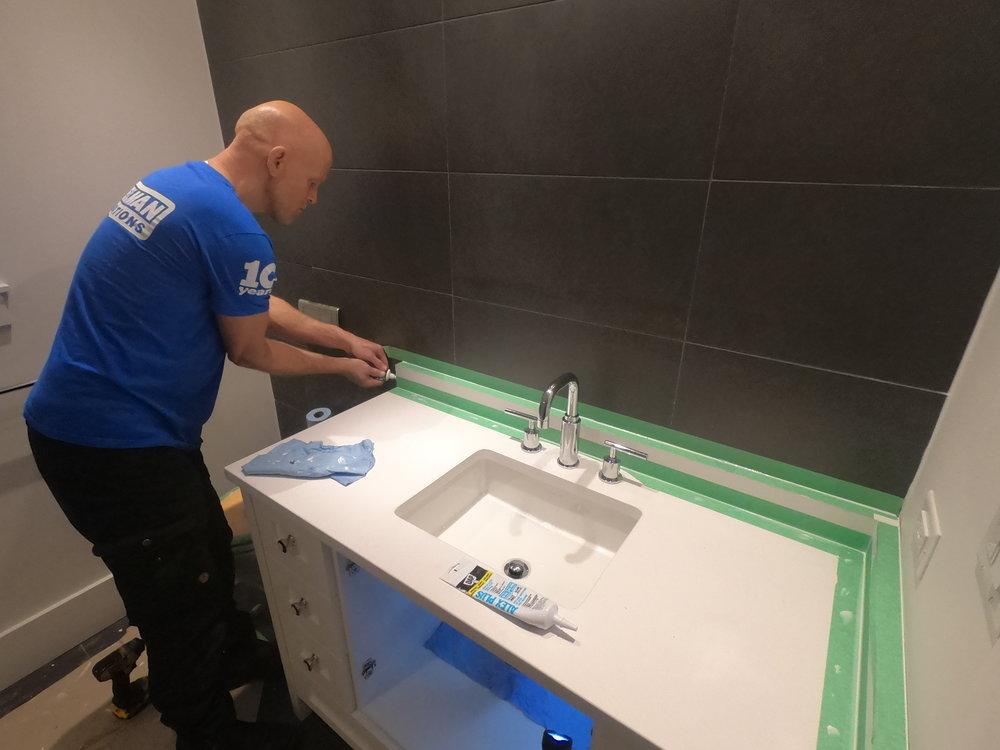 Caulking bathroom countertop for waterproofing