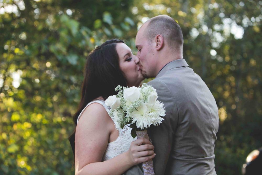 nashville wedding photographers kiss flower.jpeg
