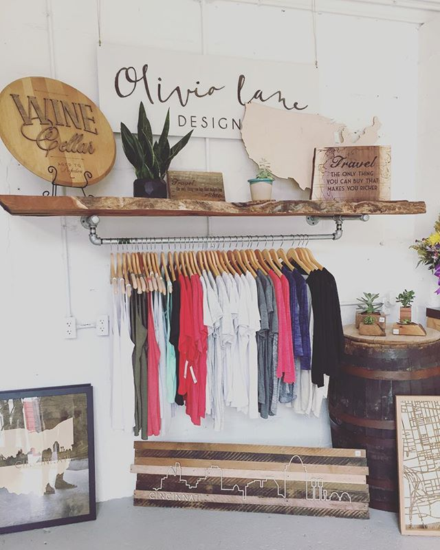 It's a beautiful day in the cov! Come shop till 3 for your momma. Lots of OL tees and @grainwell wooden goods in store (and online 😊) #lovemyol #mothersday #wooddecor #handcrafted #tees