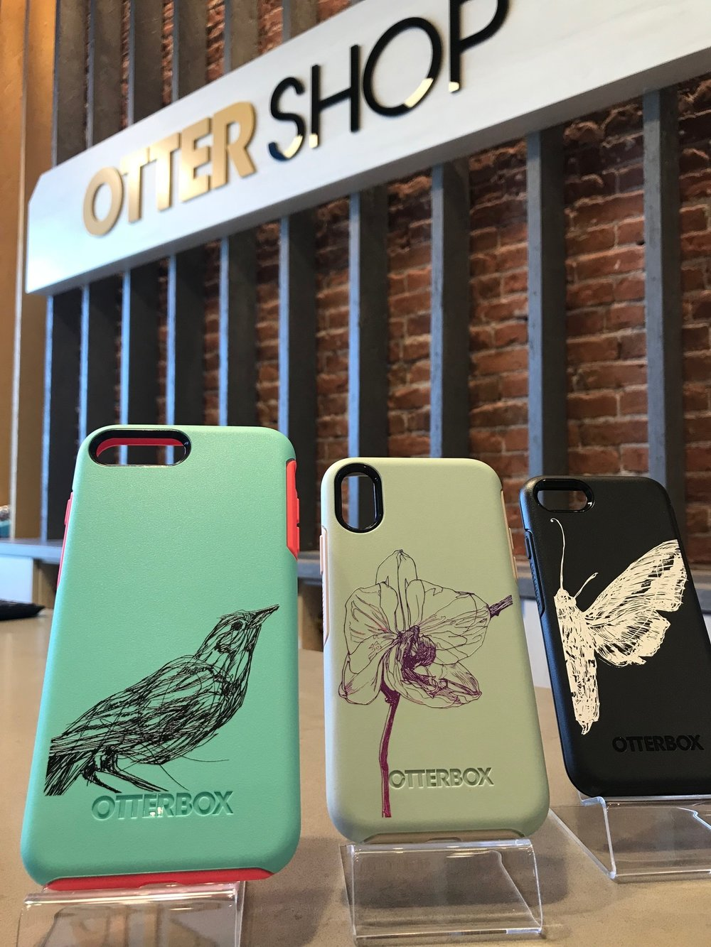 Three drawings by Melissa Carmon on Otterbox cases