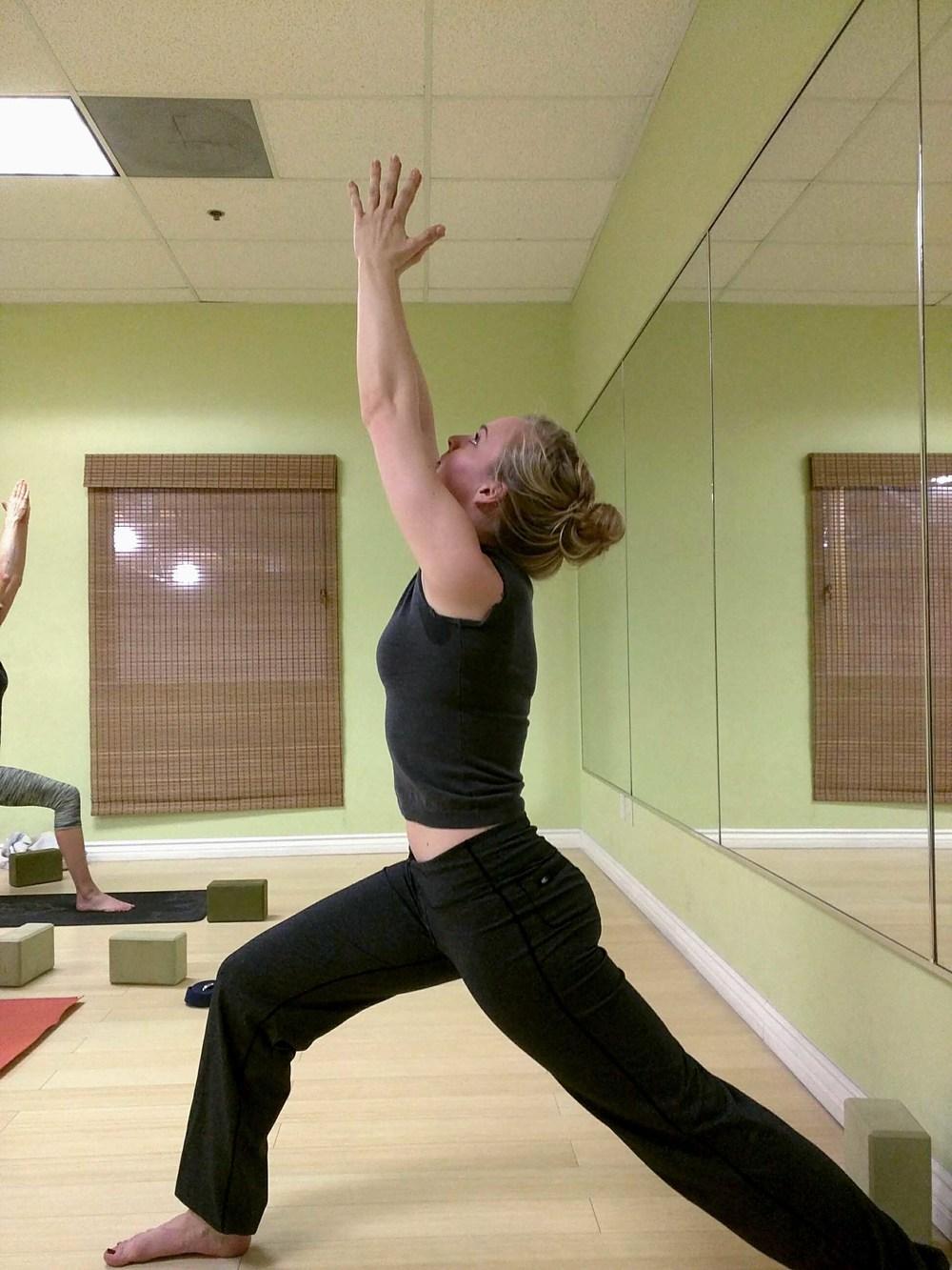 Teacher instructing yoga