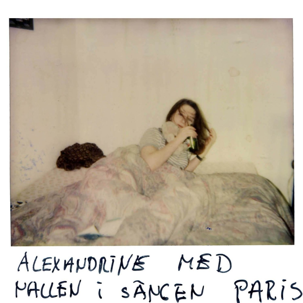 Alexandrine with her teddy bear in the bed.  Paris