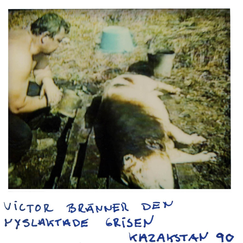 Victor is burning the freshly  slaughtered pig   Kazakhstan  -90