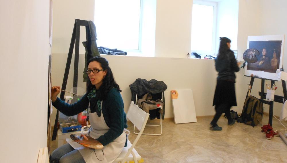 painting in the studio, alongside  Arantza MARTINEZ