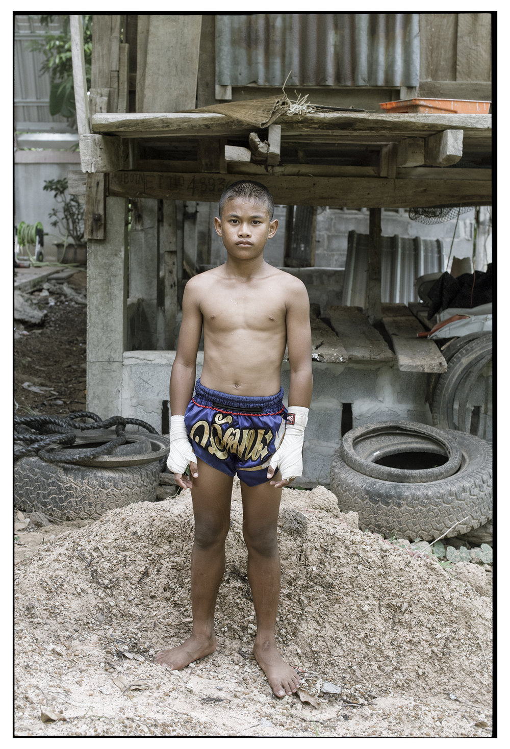 Name: Dee Age: 12 Born: Nakhonratchasima Province Dee lives with his grandma as his mother works as menial labour in the city. He's only just started out his career as a fighter but hopes to fight on TV.