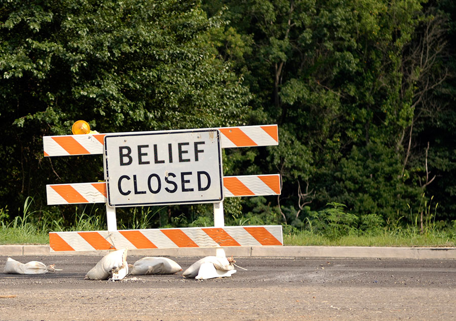 Belief closed road sign