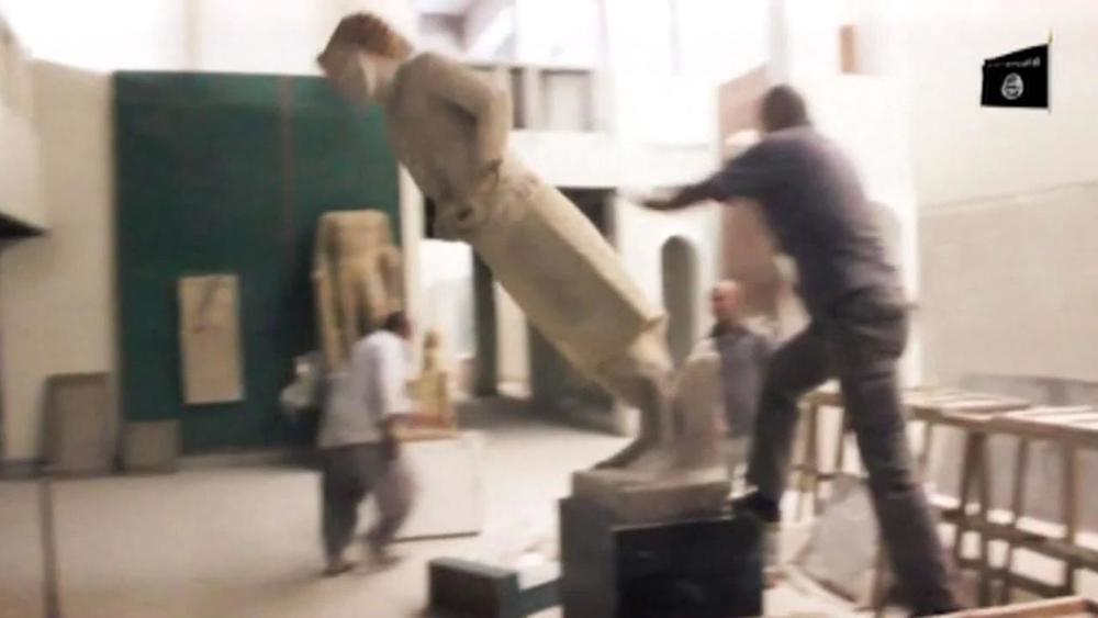 ISIS militants stage media event, toppling Assyrian statues in Mosul Museum (February 2015)