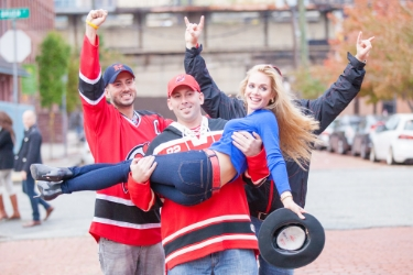 Devyn lifted by NJ Devils fans Ironbound Newark.jpg