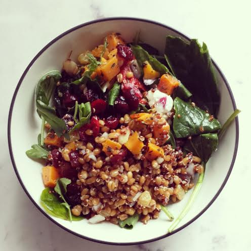 {Butternut squash, baby arugula, dried cranberries, red quinoa, diced onions, red peppers, and toasted almonds}