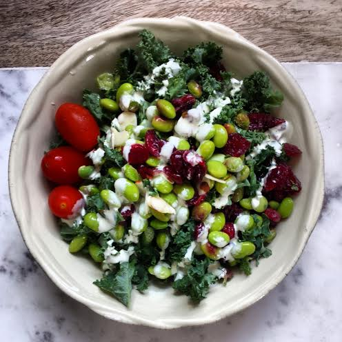{Fresh chopped kale, edamame, cherry tomatoes, dried cranberries, and toasted almonds with greek yogurt ranch dressing}