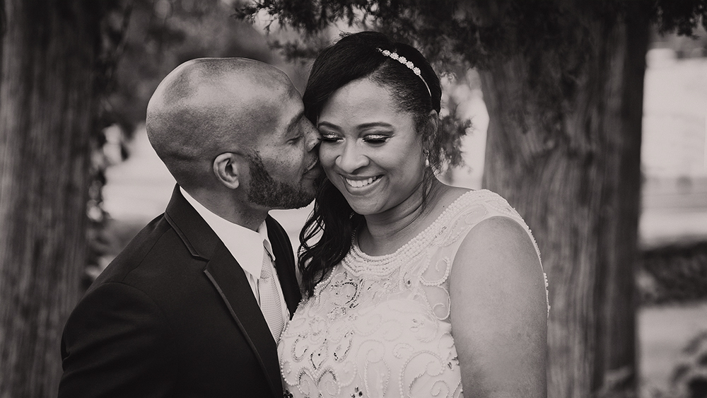 Groom Kissing Bride African American Beautiful Cedar Tree B&W South Bend Indiana Michigan Chicago - joannaFOTOGRAF Joanna Reichert.jpg