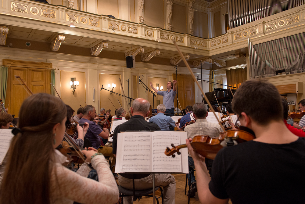 Mikel Toms and the Brno Philharmonic Orchestra recording Martin Hebel's  Symphony No.3 in E Minor: Concert in Three Acts - Act III: VI.   Poco più mosso—Più agitato—Allegro maestoso , (June 2015).