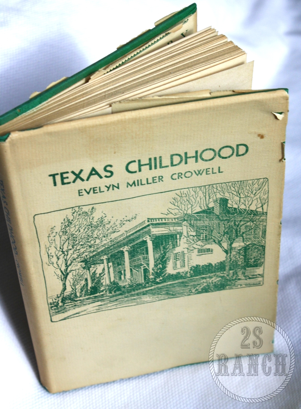 "Evelyn's book, ""Texas Childhood,"" with a picture of the Millermore Mansion on the cover."