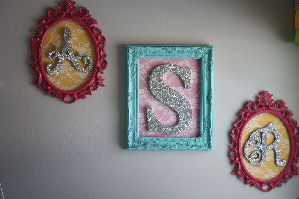 Holly had Trent paint these vintage frames and she glittered letters for Cowgirl A's initials. They kept the letters hidden until after she was born and they revealed her name.