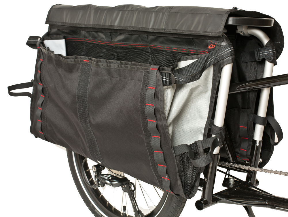 X2 has two ways to carry your cargo. First, the CargoBay, a spacious pocket perfect for groceries and smaller cargo. Second, the classic Xtracycle FreeLoader flap, ideal for umbrellas to chairs to camping gear to bags of mulch or (more) groceries. Included X2 Rain Lids keep your gear dry and secure on the go.