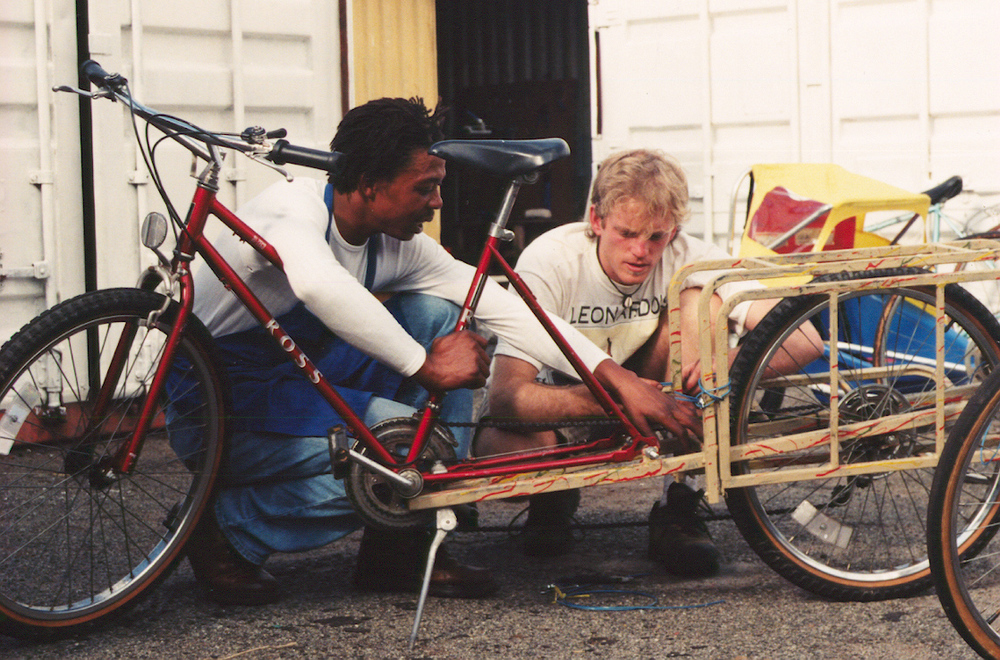 Ross and Sam working on an Xtracycle prototype in South Africa, 1999