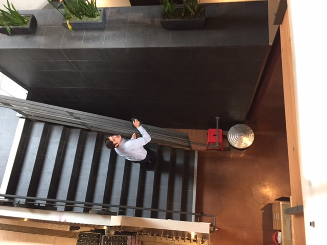 Caught Dima Galkin getting into the spirit-putting lights on our stairs...