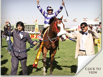 J&B Met winner Past Master with owner Hassan Adams