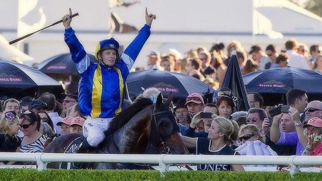 James McDonald celebrates aboard It's A Dundeel