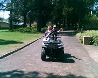 michelle and greig muir on quad bike
