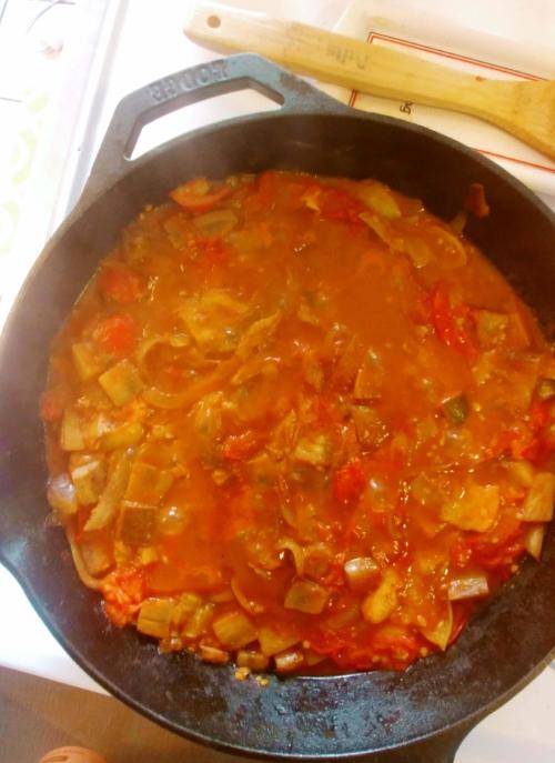 Shakshuka simmering in tomatoes
