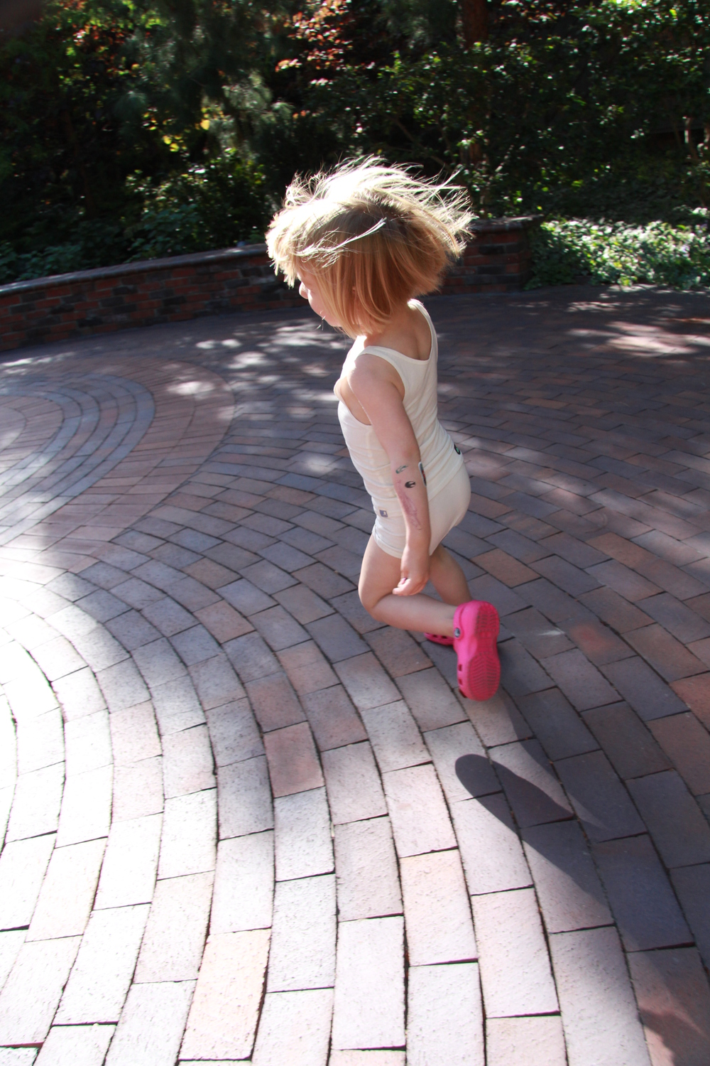 Coco is moving quite freely in her cute Dino Play Wear and pink crocs!