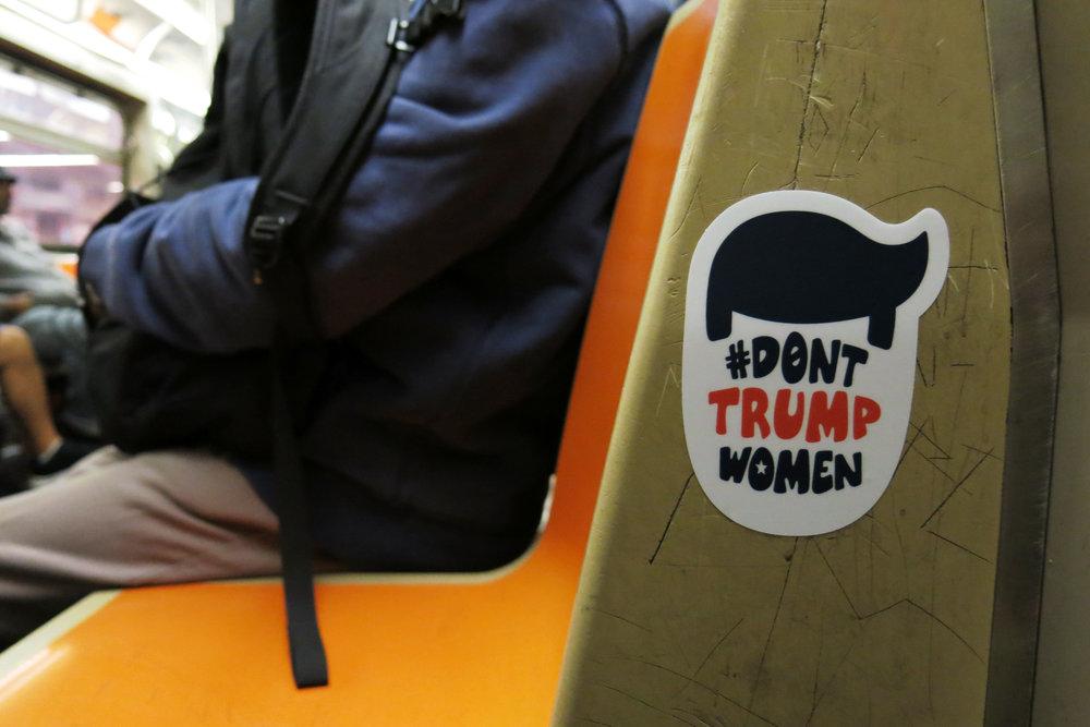 #DontTrumpWomen Trump Head Sticker  D Train, New York, NY ©2016-2017 The Femme Project