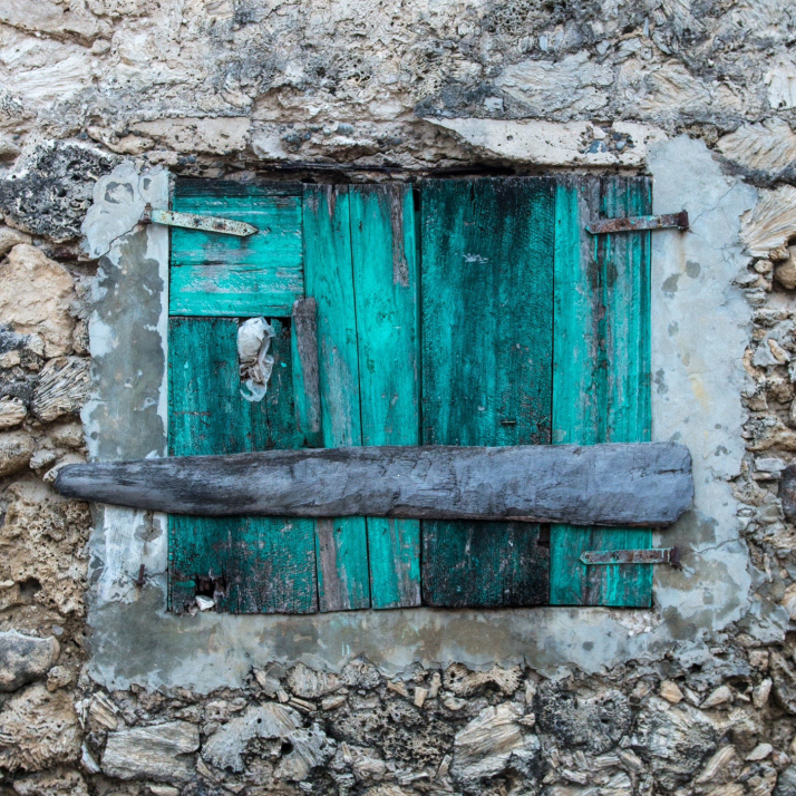 Colorful windows and doors line the streets of the coastal village of Anse d'Hainault, Haiti.
