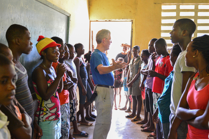 My friend Mike teaching salutations to some eager learners during the soccer camp.