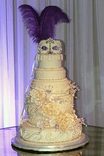 How about a wedding cake with a mask as a topper?