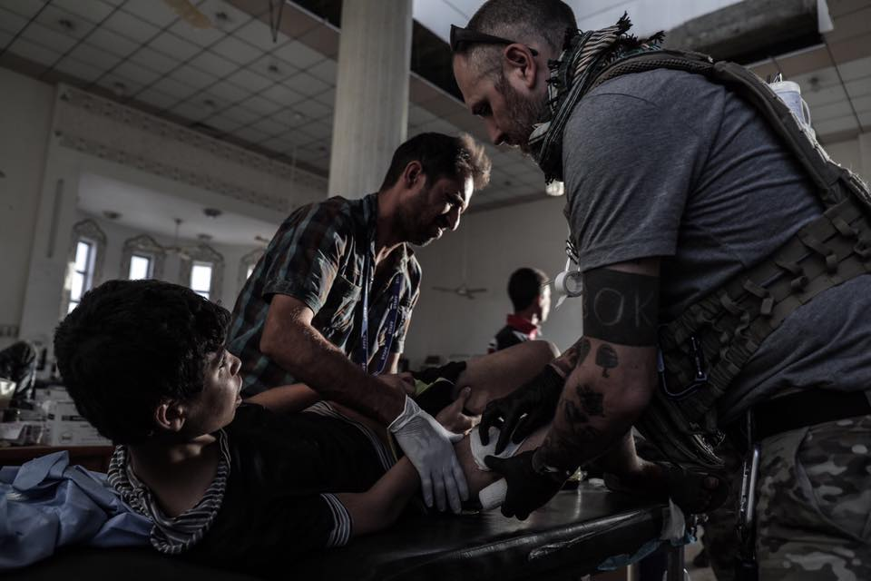 Global Response Management Team Members providing emergency trauma care to a child in Iraq.