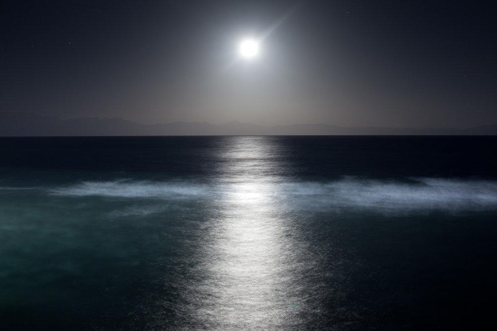 A moon shines over the bay of Aqaba between Egypt's Sinai peninsula and Saudi-Arabia.