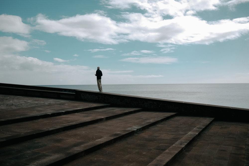 A man and the Atlantic Ocean.