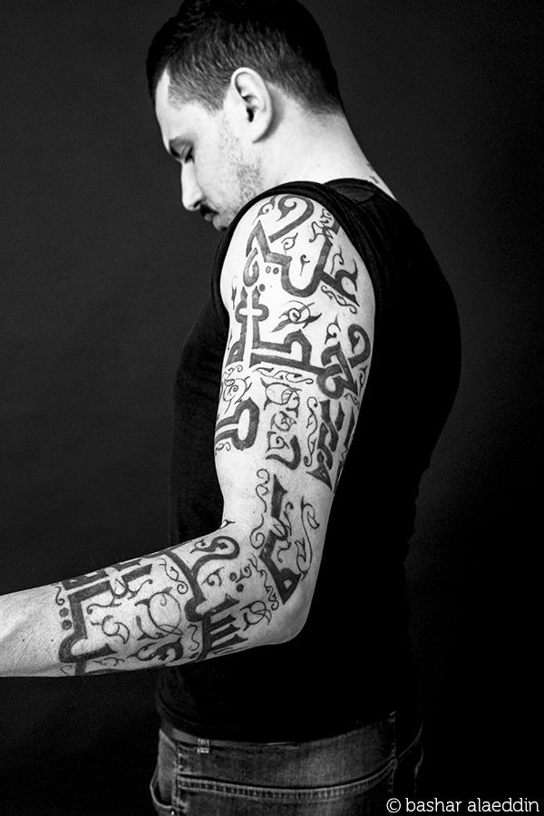 """على هذه الأرض ما يستحقّ الحياة."" – محمود درويش I am a PhD holder, and for us particularly, tattoos are taboos in the Middle East. Thus, with my tattoo I try to debunk stereotypes and resist the status quo. I believe my body is mine - as long as I am alive, to use and abuse. My body is my own canvas on which I paint and draw. My skin is the walls on which I graffiti.  I believe a tattoo is a form of art. A tattoo and a poem, for example, are the same: both are crafted with patience and love. They are both painfully beautiful and beautifully painful.  I did it for the idea of Palestine; the memory, not the geography."