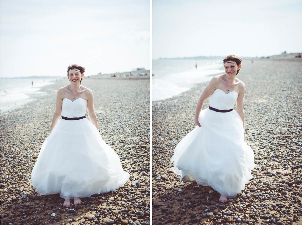 Bride photographs on the beach