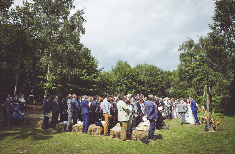 wedding guests seated on straw bales
